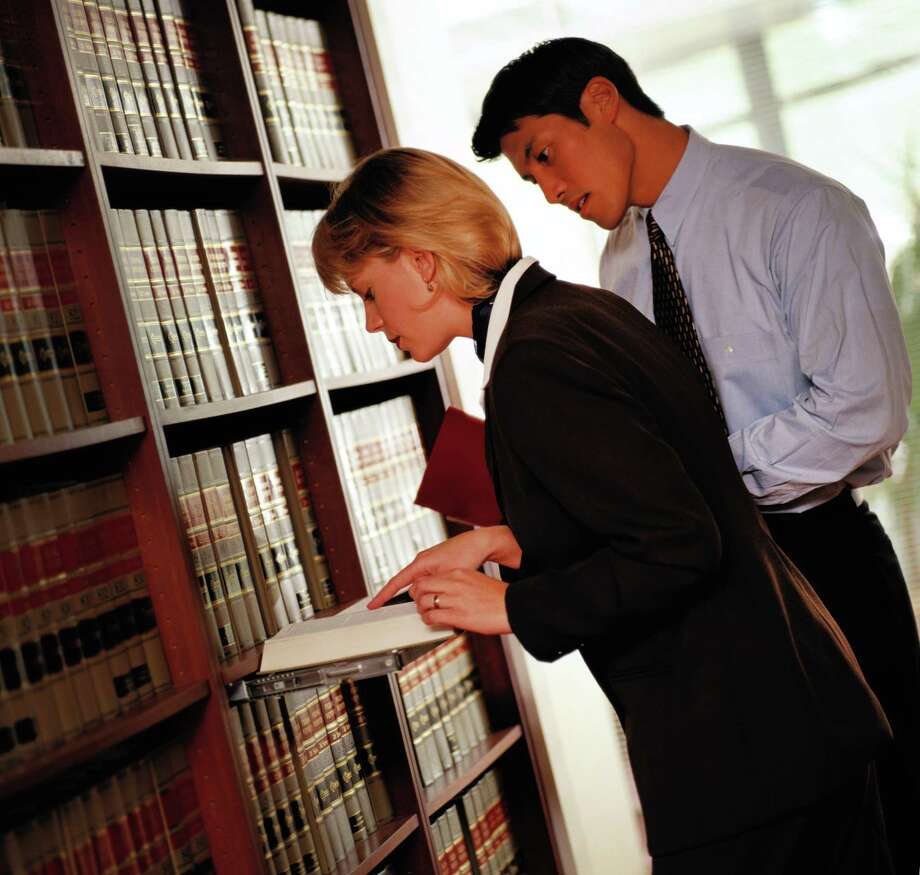 Paralegals can handle many facets of the legal process, including investigating the facts of a case; and conducting research on relevant laws, regulations and legal articles. / (c) Keith Brofsky