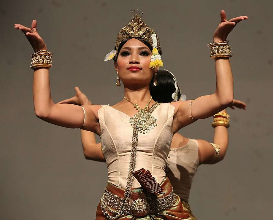 "Sophy Julie Nuth dances in ""Blossoming Antiquities,"" inspired by a 1906 tour of France by a Cambodian dance troupe. Photo: Liz Hafalia, The Chronicle"