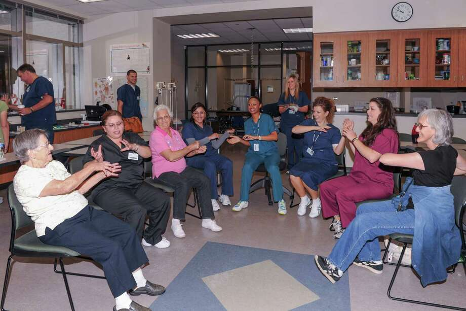 Lone Star College-Kingwood occupational therapy students work with community members, conducting low-impact sit-and-be-fit exercise program, with basic stretches and movements to promote flexibility, sitting balance, endurance and social interaction.