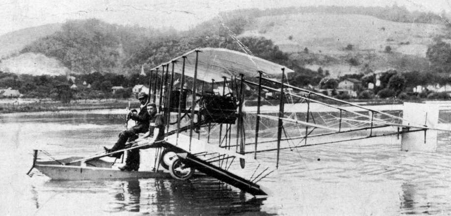 American aviation pioneer Glenn Curtiss had more success with his Model E, which first flew in 1911. Here, Curtiss, with cap on, and Lt. Theodore Ellyson test the A-1, which was a military version and the first U.S. Navy airplane, at Lake Kenka, N.Y. Photo: Hulton Archive, Getty Images / Hulton Archive