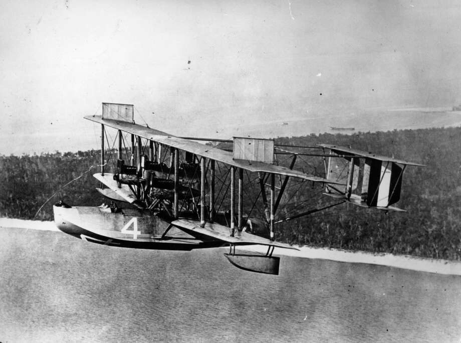 In May 1919, this Curtiss NC-4 became the first aircraft to cross the Atlantic Ocean, hopping from New York to Lisbon, Portugal, in 19 days. Here, it flies over the coast of Florida during  the historic trip. Photo: Hulton Archive, Getty Images / Hulton Archive