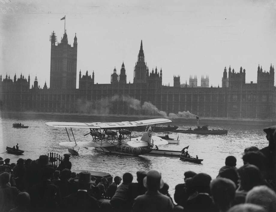 "Over in England, the Short Brothers S.8 ""Calcutta"" first flew in 1928. It had three engines and 15 passenger seats. Here it is on the River Thames outside of Parliament, in London. Photo: William A. Atkins, Getty Images / Hulton Archive"