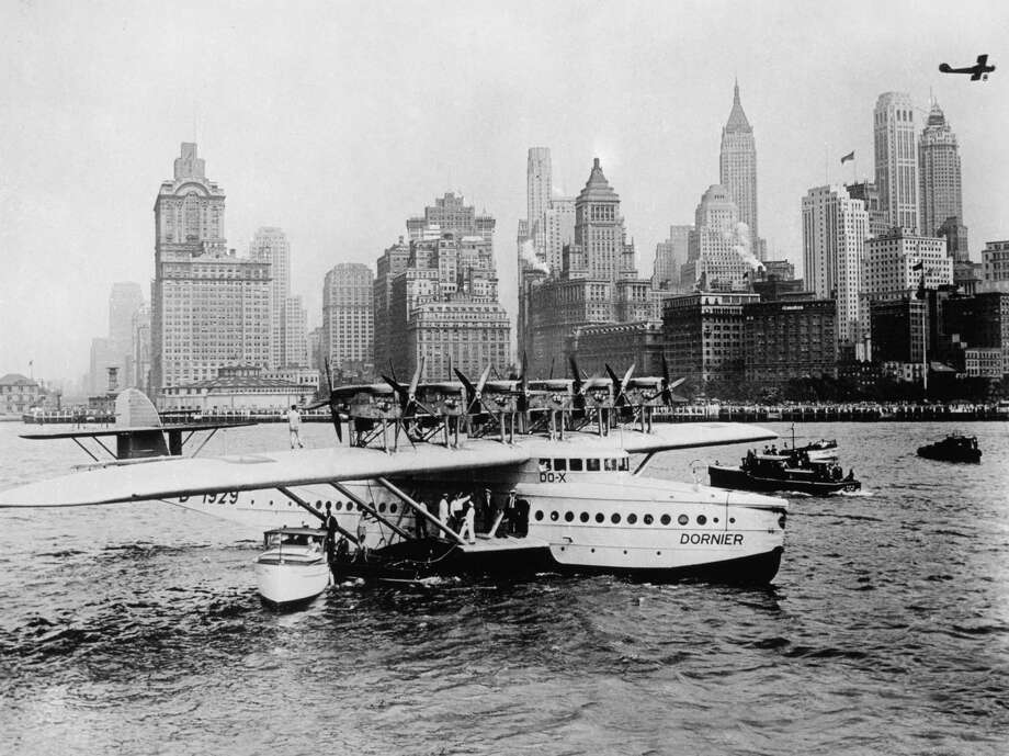 The German Dornier DOX flying boat was the largest airplane in the world when it was built in 1929. Here, it arrives in New York in 1931. It was powered by 12 engines mounted on six nacelles. Photo: Popperfoto, Popperfoto.com / popperfoto.com