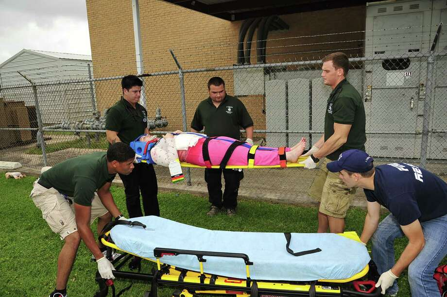 "San Jacinto College EMT students participated in mock-accident scenes during Field Day training exercises staged recently at the North Campus. From left: Jarred Goudeau, Alfonso de los Reyes, Joshua Losier, Cody Adams and Joe Cordell. Jennifer Maynard, on the stretcher, served as the ""victim."""