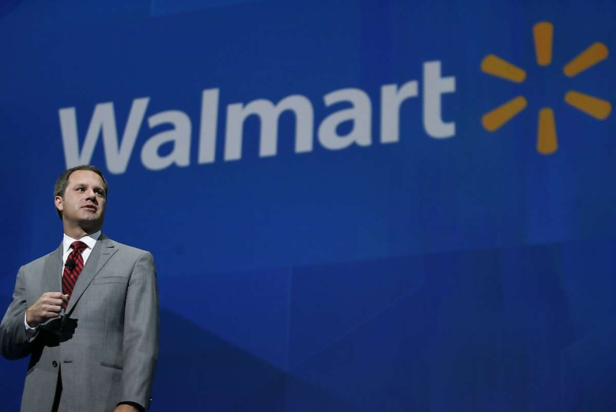 President and CEO, Walmart International Doug McMillan addresses the crowd on Wal-Mart's worldwide sales during the Walmart shareholders meeting in Fayetteville, Ark., Friday, June 7, 2013. (AP Photo/Gareth Patterson)