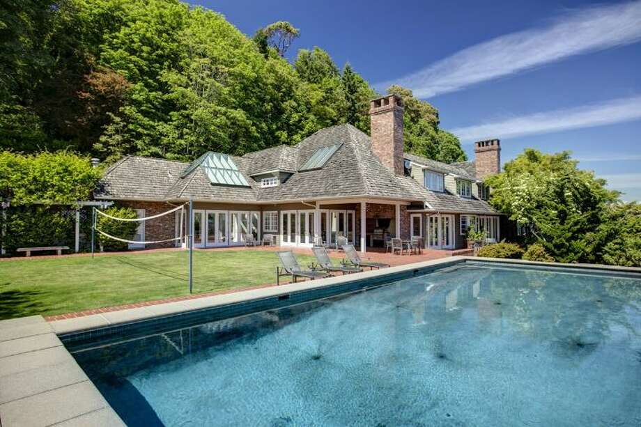 Heated pool and back yard of 4939 N.E. Laurelcrest Lane, in Laurelhurst. The 9,762-square-foot mansion, built in 1989, has six bedrooms, 5.25 bathrooms, vaulted ceilings, a family room, an office, a game room, a study, a bar, five fireplaces, a spa, a gazebo, a patio, a two-car garage and two docks on a 1.2 acre lot with 180 feet of Lake Washington frontage. It's listed for $10.8 million. Photo: Courtesy Barbara Shikiar, Windermere Real Estate