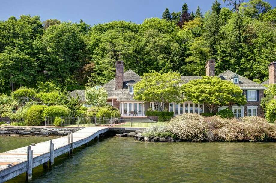 View from dock of 4939 N.E. Laurelcrest Lane, in Laurelhurst. The 9,762-square-foot mansion, built in 1989, has six bedrooms, 5.25 bathrooms, vaulted ceilings, a family room, an office, a game room, a study, a bar, five fireplaces, a spa, a heated pool, a gazebo, a patio, a two-car garage and two docks on a 1.2 acre lot with 180 feet of Lake Washington frontage. It's listed for $10.8 million. Photo: Courtesy Barbara Shikiar, Windermere Real Estate