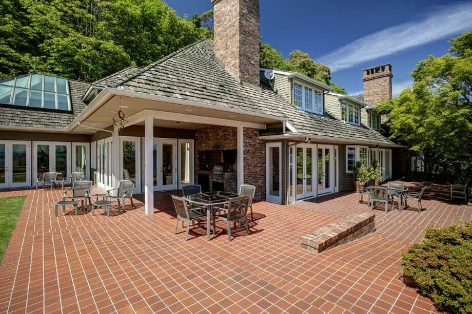 Patio of 4939 N.E. Laurelcrest Lane, in Laurelhurst. The 9,762-square-foot mansion, built in 1989, has six bedrooms, 5.25 bathrooms, vaulted ceilings, a family room, an office, a game room, a study, a bar, five fireplaces, a spa, a heated pool, a gazebo, a patio, a two-car garage and two docks on a 1.2 acre lot with 180 feet of Lake Washington frontage. It's listed for $10.8 million. Photo: Courtesy Barbara Shikiar, Windermere Real Estate