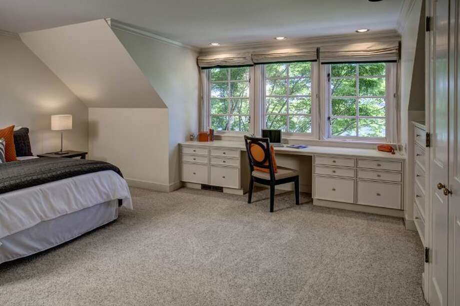 Bedroom of 4939 N.E. Laurelcrest Lane, in Laurelhurst. The 9,762-square-foot mansion, built in 1989, has six bedrooms, 5.25 bathrooms, vaulted ceilings, a family room, an office, a game room, a study, a bar, five fireplaces, a spa, a heated pool, a gazebo, a patio, a two-car garage and two docks on a 1.2 acre lot with 180 feet of Lake Washington frontage. It's listed for $10.8 million. Photo: Courtesy Barbara Shikiar, Windermere Real Estate