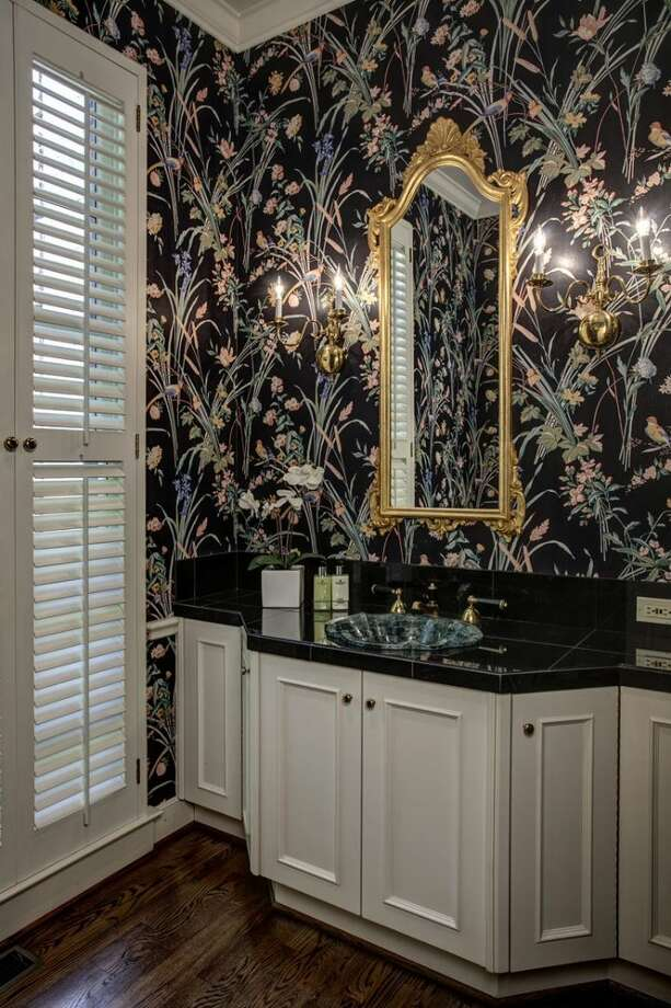 Powder room of 4939 N.E. Laurelcrest Lane, in Laurelhurst. The 9,762-square-foot mansion, built in 1989, has six bedrooms, 5.25 bathrooms, vaulted ceilings, a family room, an office, a game room, a study, a bar, five fireplaces, a spa, a heated pool, a gazebo, a patio, a two-car garage and two docks on a 1.2 acre lot with 180 feet of Lake Washington frontage. It's listed for $10.8 million. Photo: Courtesy Barbara Shikiar, Windermere Real Estate