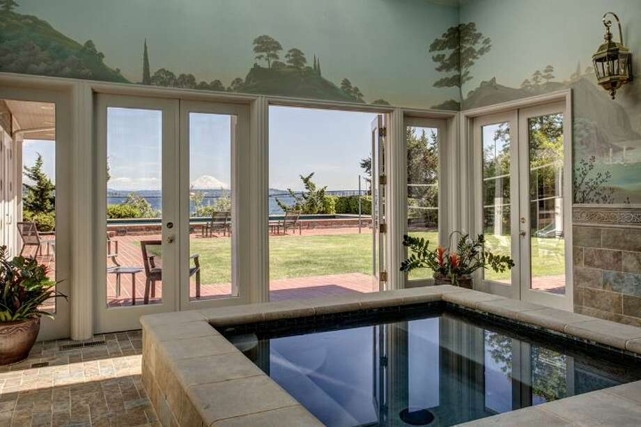 Spa of 4939 N.E. Laurelcrest Lane, in Laurelhurst. The 9,762-square-foot mansion, built in 1989, has six bedrooms, 5.25 bathrooms, vaulted ceilings, a family room, an office, a game room, a study, a bar, five fireplaces, a heated pool, a gazebo, a patio, a two-car garage and two docks on a 1.2 acre lot with 180 feet of Lake Washington frontage. It's listed for $10.8 million. Photo: Courtesy Barbara Shikiar, Windermere Real Estate