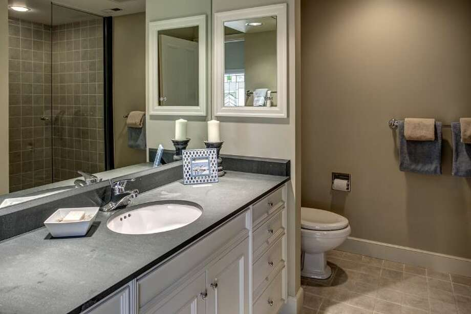 Master bathroom of 4939 N.E. Laurelcrest Lane, in Laurelhurst. The 9,762-square-foot mansion, built in 1989, has six bedrooms, 5.25 bathrooms, vaulted ceilings, a family room, an office, a game room, a study, a bar, five fireplaces, a spa, a heated pool, a gazebo, a patio, a two-car garage and two docks on a 1.2 acre lot with 180 feet of Lake Washington frontage. It's listed for $10.8 million. Photo: Courtesy Barbara Shikiar, Windermere Real Estate