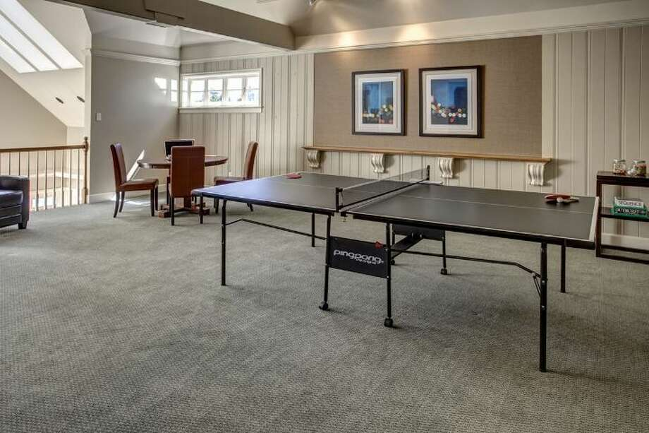 Game room of 4939 N.E. Laurelcrest Lane, in Laurelhurst. The 9,762-square-foot mansion, built in 1989, has six bedrooms, 5.25 bathrooms, vaulted ceilings, a family room, an office, a study, a bar, five fireplaces, a spa, a heated pool, a gazebo, a patio, a two-car garage and two docks on a 1.2 acre lot with 180 feet of Lake Washington frontage. It's listed for $10.8 million. Photo: Courtesy Barbara Shikiar, Windermere Real Estate