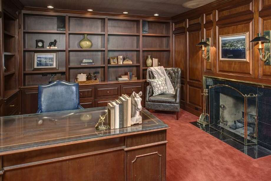 Office of 4939 N.E. Laurelcrest Lane, in Laurelhurst. The 9,762-square-foot mansion, built in 1989, has six bedrooms, 5.25 bathrooms, vaulted ceilings, a family room, a game room, a study, a bar, five fireplaces, a spa, a heated pool, a gazebo, a patio, a two-car garage and two docks on a 1.2 acre lot with 180 feet of Lake Washington frontage. It's listed for $10.8 million. Photo: Courtesy Barbara Shikiar, Windermere Real Estate