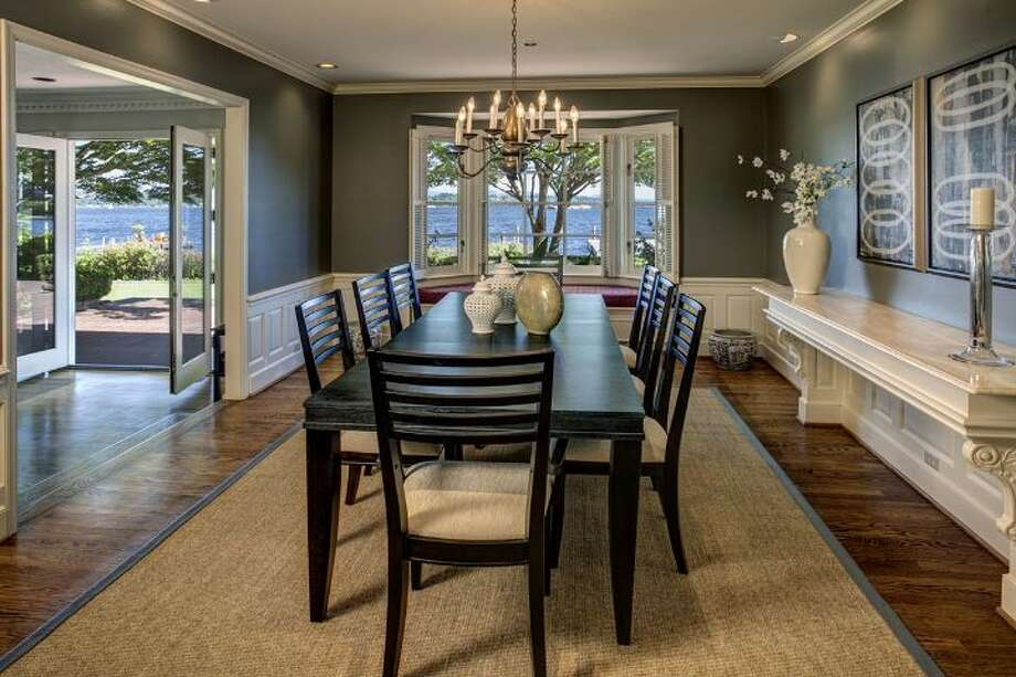 Dining room of 4939 N.E. Laurelcrest Lane, in Laurelhurst. The 9,762-square-foot mansion, built in 1989, has six bedrooms, 5.25 bathrooms, vaulted ceilings, a family room, an office, a game room, a study, a bar, five fireplaces, a spa, a heated pool, a gazebo, a patio, a two-car garage and two docks on a 1.2 acre lot with 180 feet of Lake Washington frontage. It's listed for $10.8 million. Photo: Courtesy Barbara Shikiar, Windermere Real Estate