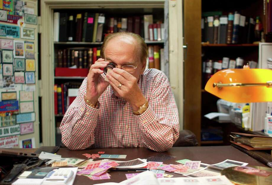"""Bob Dumaine, owner of Sam Houston Duck Co., is a prolific collector of Federal Duck Stamps and has written a book on the subject titled """"The Duck Stamp Story."""" He began collecting stamps in high school. Photo: Johnny Hanson, Staff / © 2013  Houston Chronicle"""