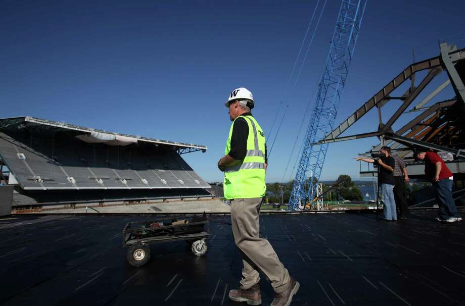 University of Washington Associate Athletic Director Chip Lydum gives a tour of the Husky Stadium construction site on Friday, August 24, 2012. Photo: JOSHUA TRUJILLO / SEATTLEPI.COM