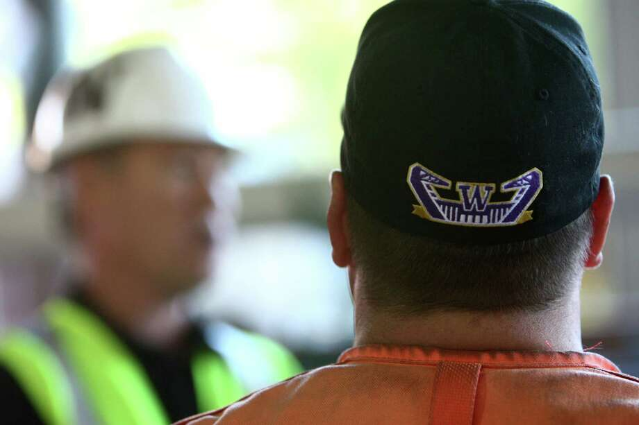 A worker wears a Husky Stadium hat during a tour of the Husky Stadium construction site on Friday, August 24, 2012. Photo: JOSHUA TRUJILLO / SEATTLEPI.COM