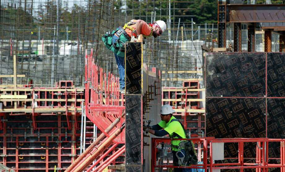 Workers prepare framing for the final footing of the south stands during renovation of Husky Stadium on Monday, April 23, 2012, in Seattle. Photo: AP