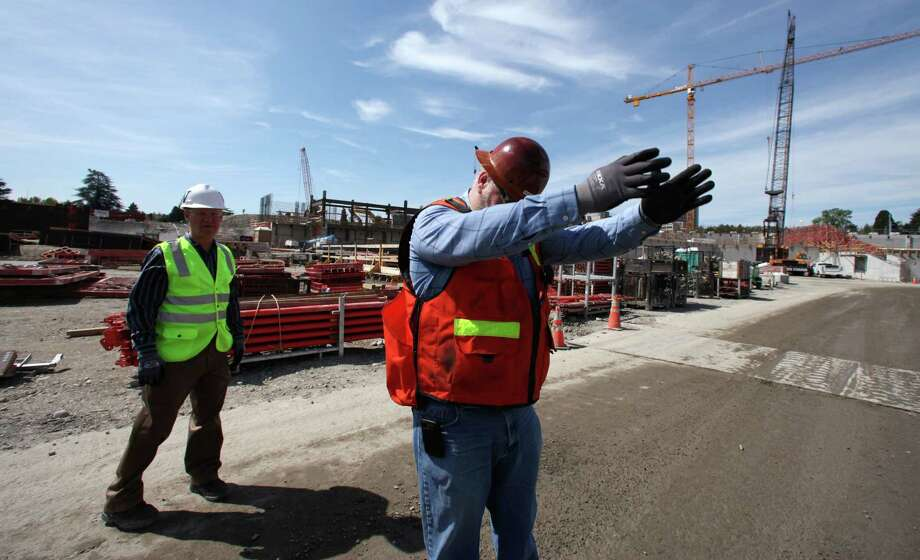 Construction supervisor Dwayne Goddard points out the approximate location of the 50-yard line during a tour for media members on progress on renovation of Husky Stadium on Monday, April 23, 2012, in Seattle. Photo: AP