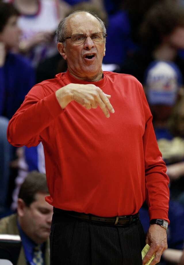 FILE - In this Jan. 2, 2011 file photo, then Miami (Ohio) coach Charlie Coles yells to his team during the first half of an NCAA college basketball game against Kansas in Lawrence, Kan. The longtime Miami coach  has died at his Oxford, Ohio, home. He was 71. (AP Photo/Orlin Wagner, File) Photo: Orlin Wagner, STF / AP