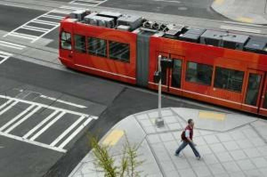 The Seattle streetcar offensive: The Center City Connector is the next project.  It is designed to link up the (popularly known) South Lake Union Trolley (S.L.U.T) with the newly opened First Hill line.  The Obama administration is proposing a $75 million grant for the project.