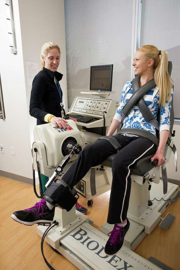 Physical therapist Tiffany Strawn works with Jennifer Rosa at TCH West Campus.