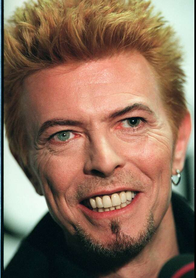 Entertainer David Bowie speaks to reporters before his performance at a concert celebrating his 50th birthday Thursday, Jan. 9, 1997, at Madison Square Garden in New York. (AP Photo/Ron Frehm) Photo: RON FREHM, ST / AP