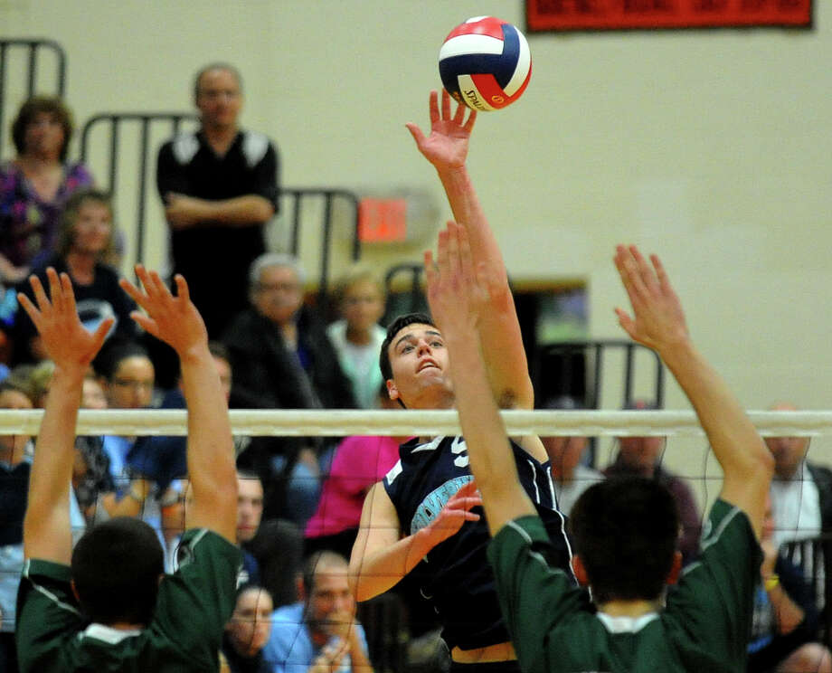 Oxford's Robert Costigan looks to score against Enfield, during Class M volleyball finals action in Shelton, Conn. on Friday June 7, 2013. Defending is Enfield's Kyle Maynard, left, and Philipp Wuellhorst. Photo: Christian Abraham / Connecticut Post