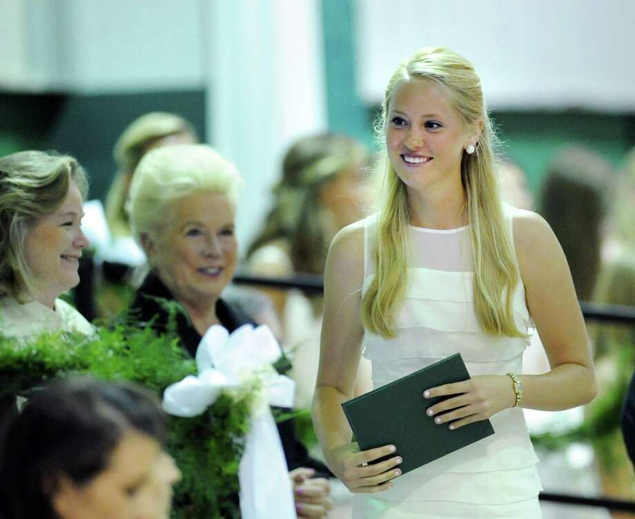 At right, Wendy Adele Collins, 18, of Greenwich, smiles after receiving her diploma during the Convent of the Sacred Heart Commencement at the school in Greenwich, Friday afternoon, June7, 2013. At center is Head of the School, Pam Hayes. Eighty-two students graduated. Photo: Bob Luckey / Greenwich Time