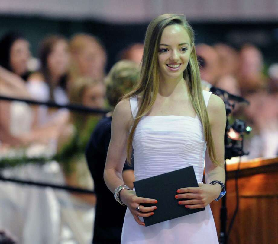 Alison Brett, 18, of Rye, N.Y., smiles after receiving her diploma during the Convent of the Sacred Heart Commencement at the school in Greenwich, Friday afternoon, June7, 2013. Eighty-two students graduated. Photo: Bob Luckey / Greenwich Time