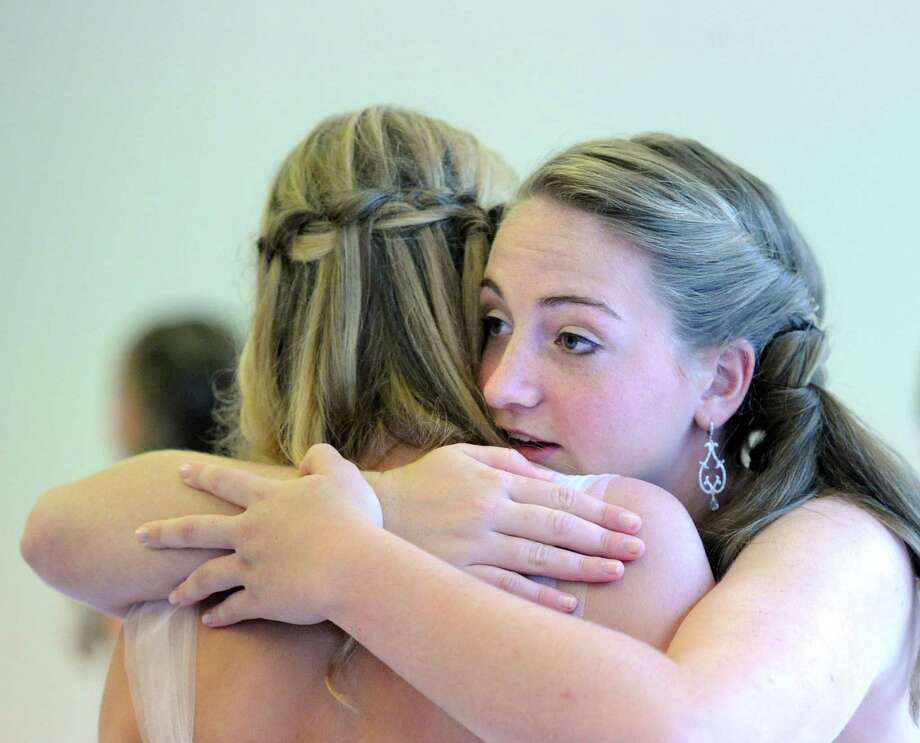 Graduating senior Jenna Ann Hascher, 17, of Stamford, hugs a fellow graduating senior during the Convent of the Sacred Heart Commencement at the school in Greenwich, Friday afternoon, June7, 2013. Eighty-two students graduated. Photo: Bob Luckey / Greenwich Time