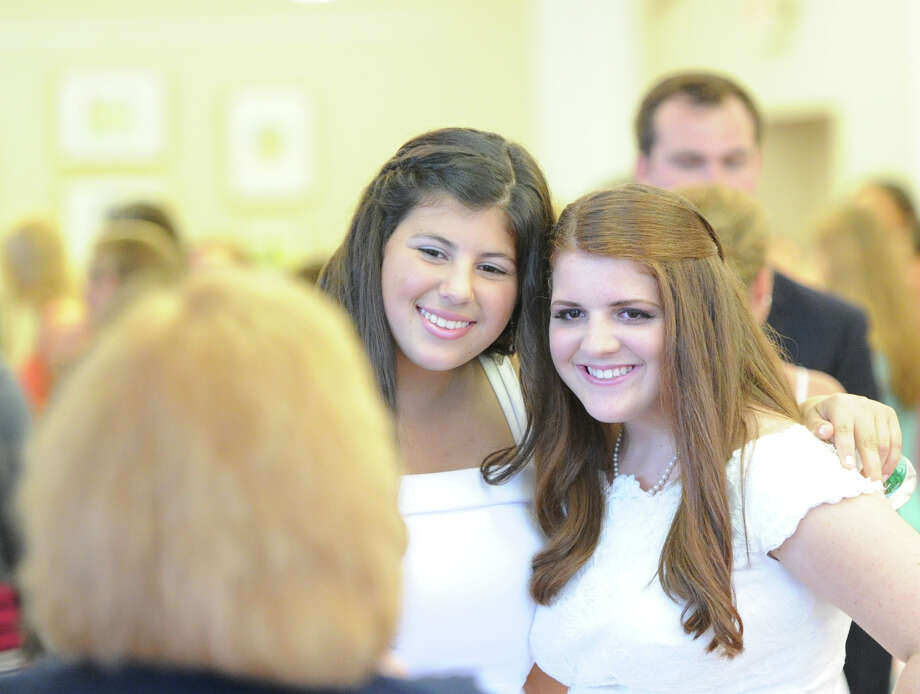 Graduating seniors, Camilla Soraya Kummen, 17, of Wilton, at left, and Jeanne Marie Fishkin, 17, of Chappaqua, N.Y., during the Convent of the Sacred Heart Commencement at the school in Greenwich, Friday afternoon, June7, 2013. Kummen's mother, Dr. Linda Vahdat, a leading breast cancer researcher, was the graduation speaker. Eighty-two students graduated. Photo: Bob Luckey / Greenwich Time