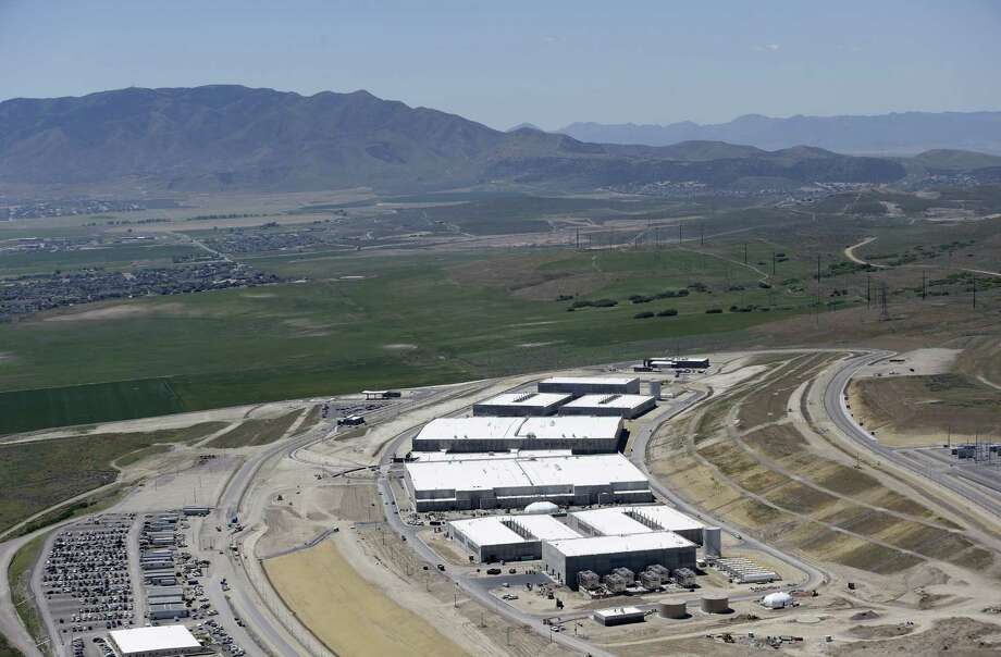 An aerial view of the NSA's Utah Data Center in Bluffdale, Utah, Thursday, June 6, 2013. The government is secretly collecting the telephone records of millions of U.S. customers of Verizon under a top-secret court order, according to the chairwoman of the Senate Intelligence Committee. The Obama administration is defending the National Security Agency's need to collect such records, but critics are calling it a huge over-reach. (AP Photo/Rick Bowmer) Photo: Rick Bowmer, STF / AP