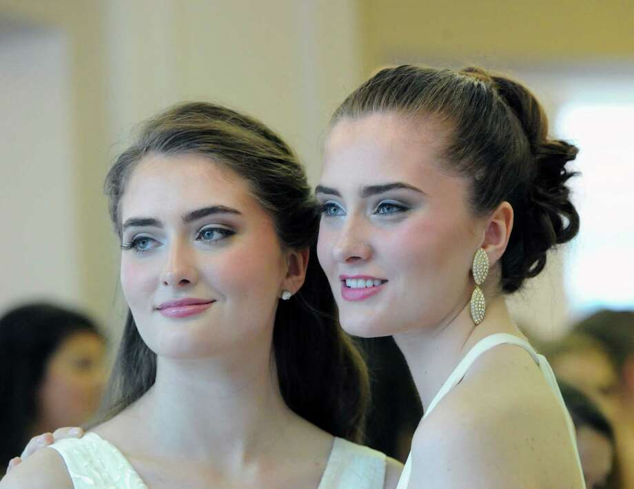 Graduating seniors, twins, Blair, left, and Morgan Kennedy, 18, of Greenwich, during the Convent of the Sacred Heart Commencement at the school in Greenwich, Friday afternoon, June7, 2013. Eighty-two students graduated. Photo: Bob Luckey / Greenwich Time