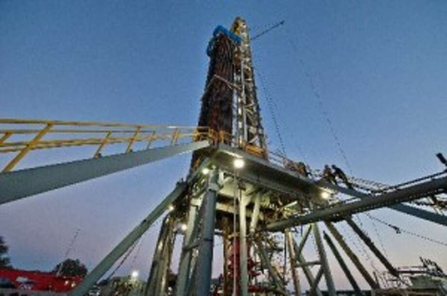 An oil & gas drilling rig is drilling a well for Pioneer Natural Resources in the Eagle Ford Shale formation near Yorktown in 2012. (Photo by Eddie Seal for The Texas Tribune
