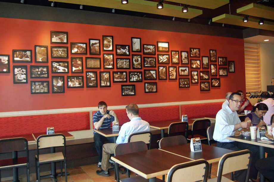 The lunch crowd enjoys the grand opening of Qdoba Mexican Grill on Monday in Norwalk. Photo: Nicole Rivard