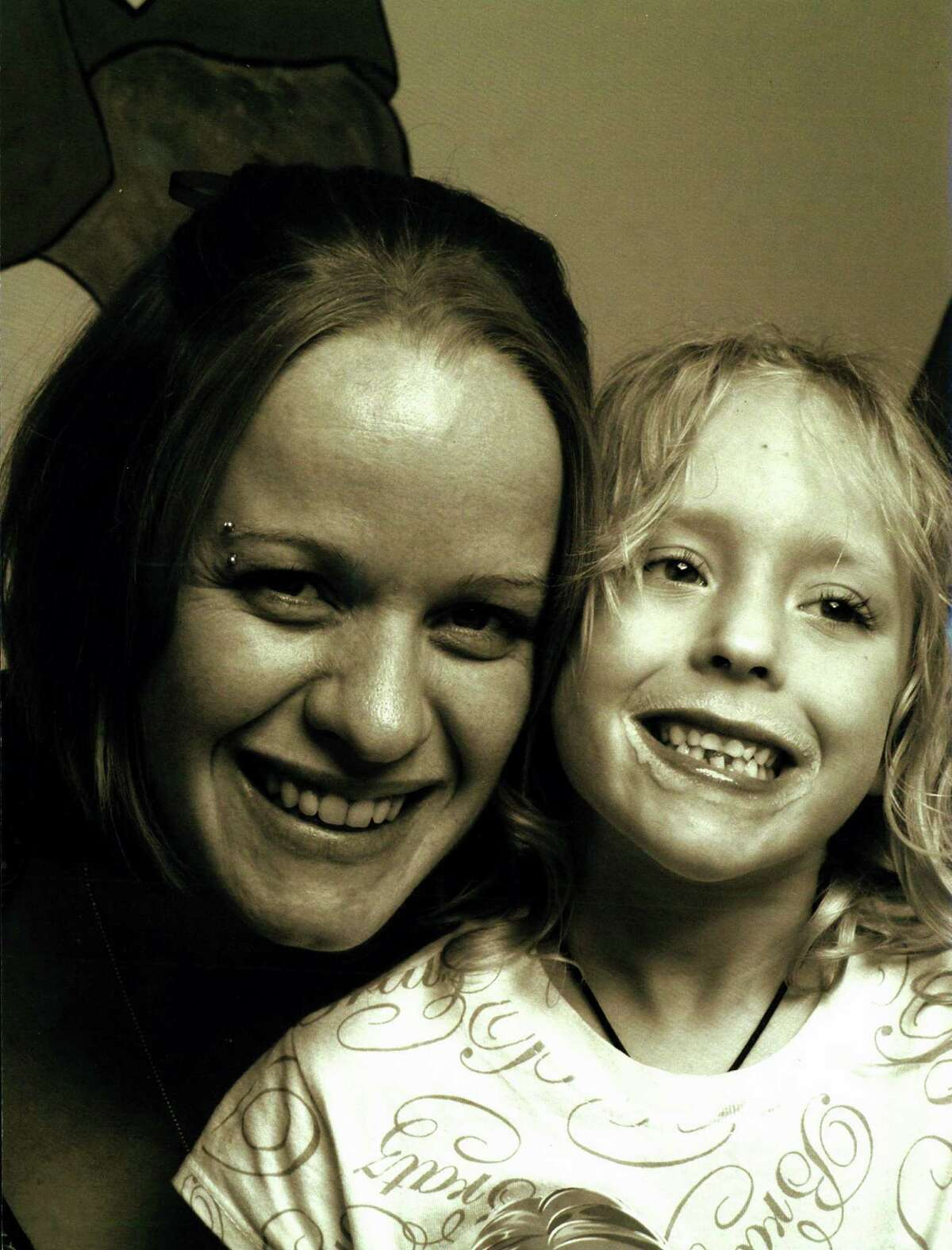 Jo-Anne Brasse (mother), now Jo-Anne Guerrero, and Sarah Brasse who died in February 2009 of untreated appendicitis at age 8.
