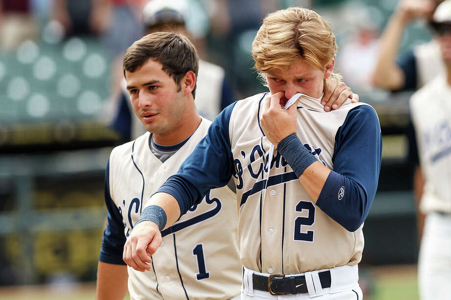 O'Connor's Nick Pena (left) comforts Zachary Davenport as the two seniors leave the field following their 2-1 loss to Conroe The Woodlands in their Class 5A state semifinal game at Dell Diamond in Round Rock on Friday, June 7, 2013.  MARVIN PFEIFFER/ mpfeiffer@express-news.net Photo: MARVIN PFEIFFER, Marvin Pfeiffer/ Express-News / Express-News 2013