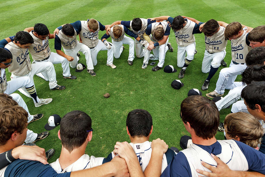 The O'Connor Panthers pause for a team prayer with a lock of Kent Corso's hair in the center of the circle prior to their Class 5A state semifinal game with Conroe The Woodlands at Dell Diamond in Round Rock on Friday, June 7, 2013.  MARVIN PFEIFFER/ mpfeiffer@express-news.net Photo: MARVIN PFEIFFER, Marvin Pfeiffer/ Express-News / Express-News 2013