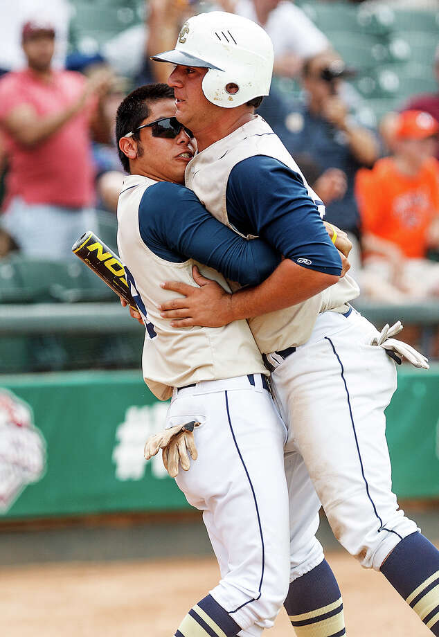 O'Connor's Jordan Martinez (left) embraces Justin Garcia after Garcia tied the game at 1-1 in the top of the seventh inning during their Class 5A state semifinal game with Conroe The Woodlands at Dell Diamond in Round Rock on Friday, June 7, 2013.  The Woodlands went on to win the game 2-1 with a walk-off home run in the bottom of the inning.  MARVIN PFEIFFER/ mpfeiffer@express-news.net Photo: MARVIN PFEIFFER, Marvin Pfeiffer/ Express-News / Express-News 2013