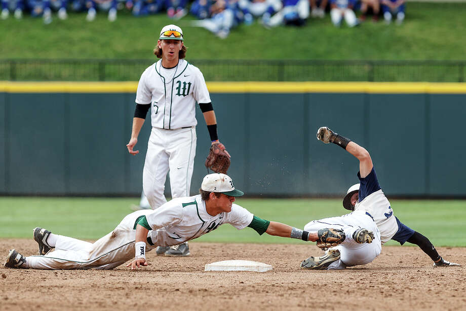 Conroe The Woodlands's Luke Sherley (left) stretches to tag out O'Connor's Zachary Galm at second base while Hillin Warren looks on after Galm overslid the bag during the seventh inning of  their Class 5A state semifinal game with Conroe The Woodlands at Dell Diamond in Round Rock on Friday, June 7, 2013.  O'Connor had tied the game 1-1 earlier in the inning but The Woodlands came back with a walk-off home run in the bottom on the inning to win the game 2-1.  MARVIN PFEIFFER/ mpfeiffer@express-news.net Photo: MARVIN PFEIFFER, Marvin Pfeiffer/ Express-News / Express-News 2013