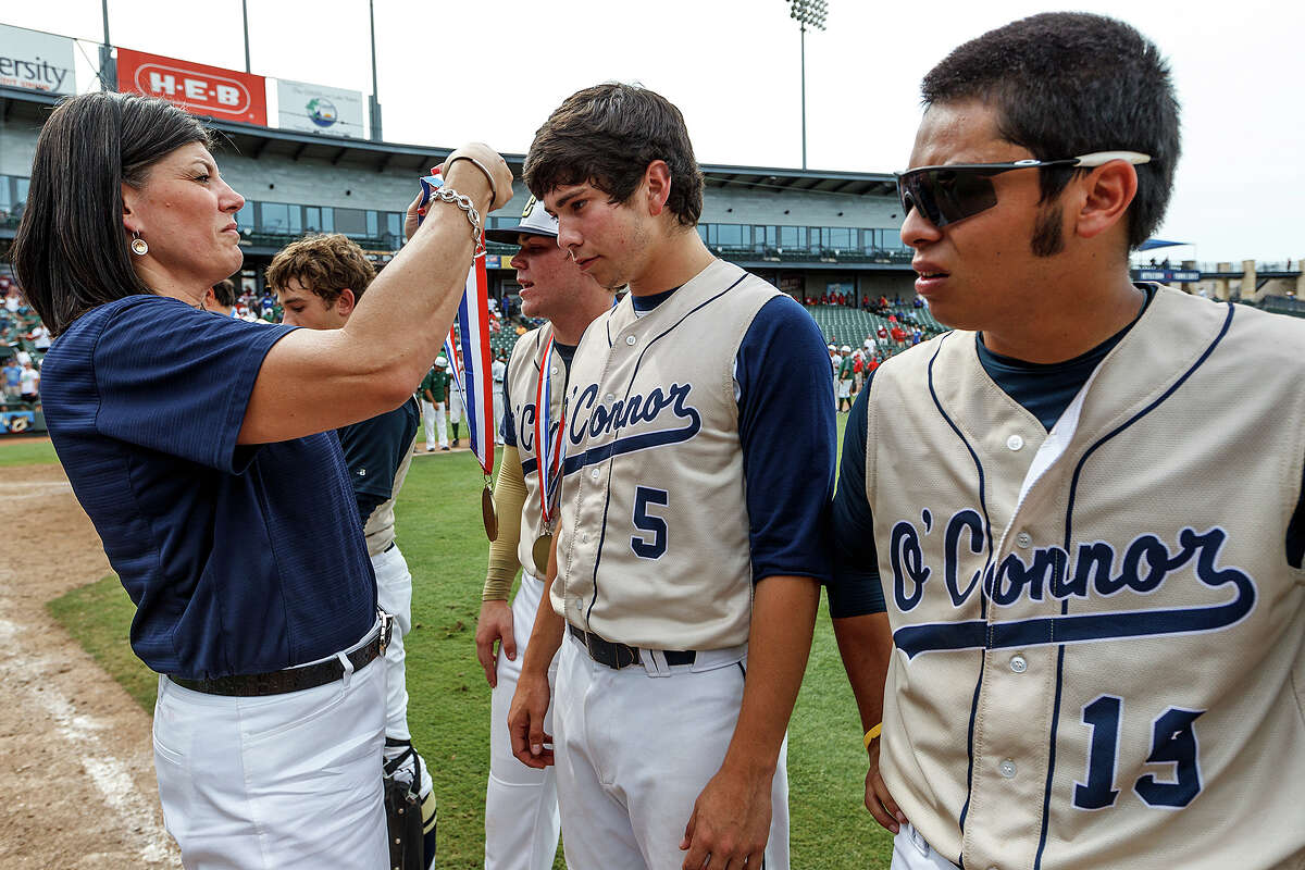 O'Connor's Mark Ecker (center) receives his runner-up medal with Jordan Martinez (right) and the rest of the Panthers following their Class 5A state semifinal game with Conroe The Woodlands at Dell Diamond in Round Rock on Friday, June 7, 2013. O'Connor lost the game 2-1. MARVIN PFEIFFER/ mpfeiffer@express-news.net