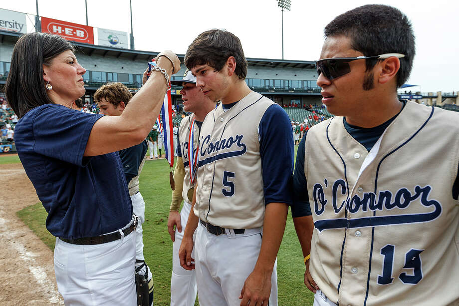 O'Connor's Mark Ecker (center) receives his runner-up medal with Jordan Martinez (right) and the rest of the Panthers following their Class 5A state semifinal game with Conroe The Woodlands at Dell Diamond in Round Rock on Friday, June 7, 2013.  O'Connor lost the game 2-1.   MARVIN PFEIFFER/ mpfeiffer@express-news.net Photo: MARVIN PFEIFFER, Marvin Pfeiffer/ Express-News / Express-News 2013