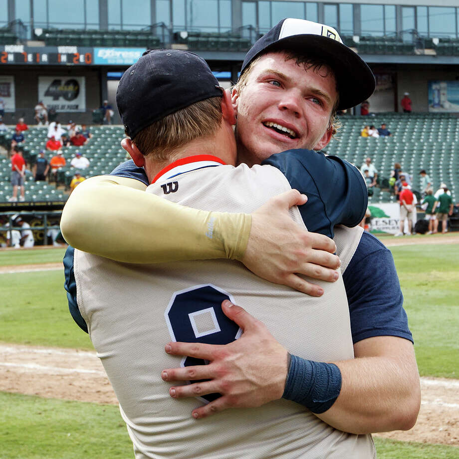 Kent Corso (right) and Billy Craft embrace folloting their Class 5A state semifinal game with Conroe The Woodlands at Dell Diamond in Round Rock on Friday, June 7, 2013. O'Connor lost the game 2-1.   MARVIN PFEIFFER/ mpfeiffer@express-news.net Photo: MARVIN PFEIFFER, Marvin Pfeiffer/ Express-News / Express-News 2013