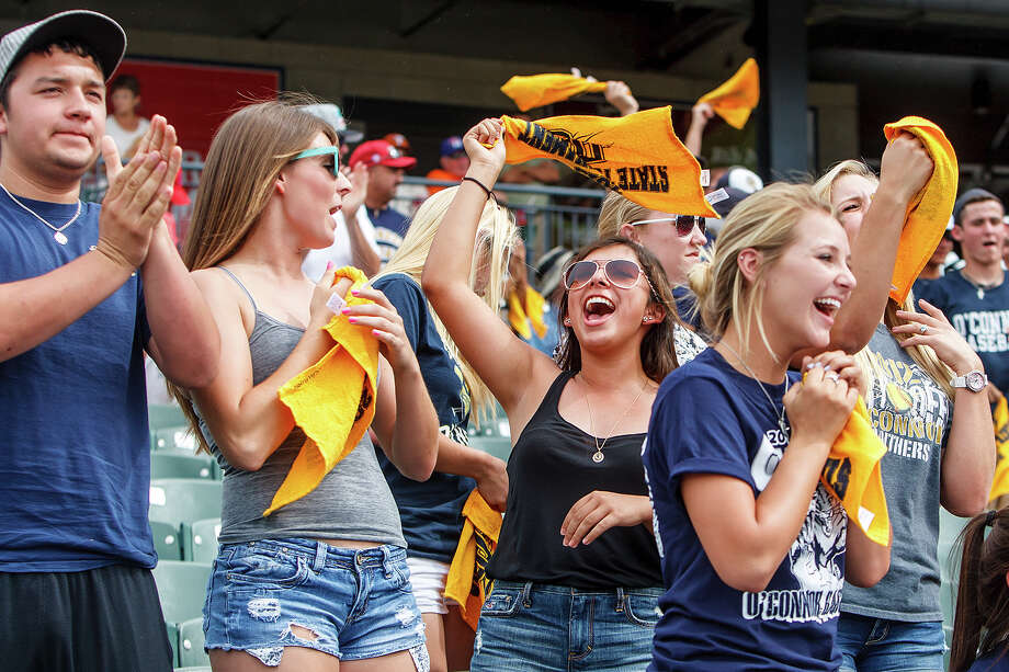 O'Connor fans celebrate in the stands as the Panthers tie the game at 1-1 in the top of the seventh inning during their Class 5A state semifinal game with Conroe The Woodlands at Dell Diamond in Round Rock on Friday, June 7, 2013.  MARVIN PFEIFFER/ mpfeiffer@express-news.net Photo: MARVIN PFEIFFER, Marvin Pfeiffer/ Express-News / Express-News 2013