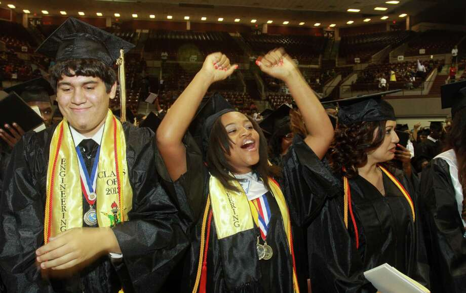 Adriane Maxie, flanked by Romelo Cabral and Janet Arce, celebrates at her graduation this week with what may be the last senior high school class in the North Forest Independent School District. Photo: Gary Fountain, Freelance / Copyright 2013 Gary Fountain
