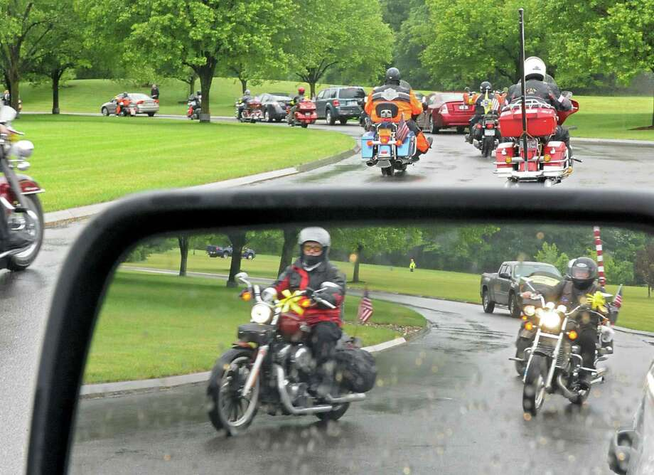 Patriot Guard Riders leave after the remains of 13 ?forgotten? veterans are buried with full military honors at Saratoga National Cemetery on Friday, June 7, 2013 in Saratoga, N.Y.  (Lori Van Buren / Times Union) Photo: Lori Van Buren / 00022736A