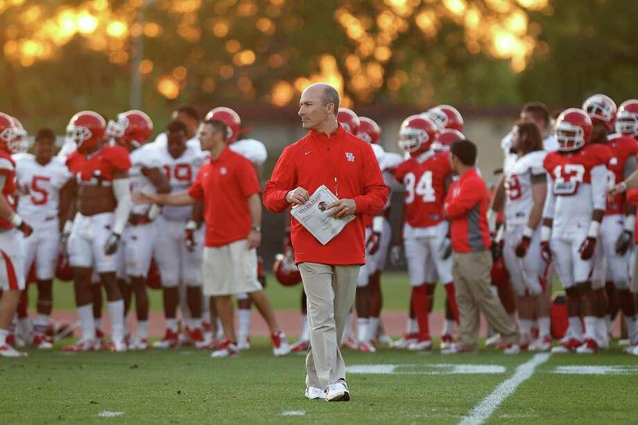 Houston coach Tony Levine  hopes he's learned from his mistakes this past year. Photo: Thomas B. Shea / © 2013 Thomas B. Shea