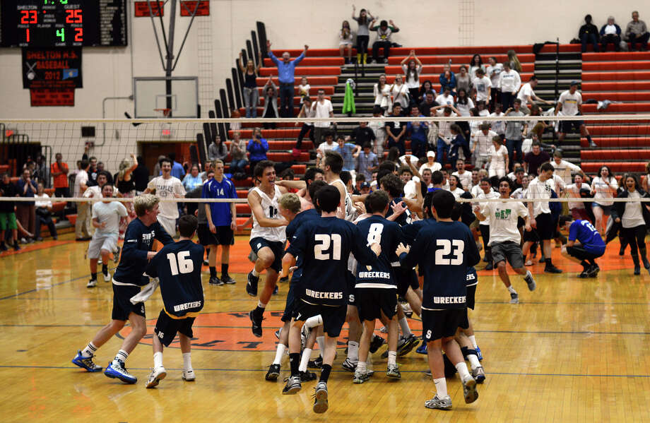 Staples celebrates its win over Glastonbury, during Class L volleyball finals action in Shelton, Conn. on Friday June 7, 2013. Photo: Christian Abraham / Connecticut Post